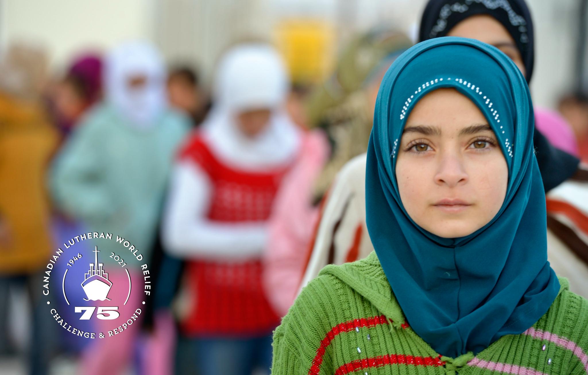 Photo of a girl in line before starting school in the Zaatari Refugee Camp, Jordan
