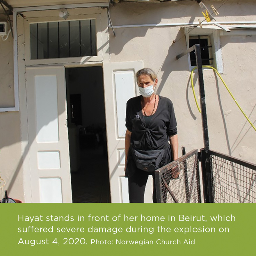 Hayat stands in front of her home in Beirut, which suffered severe damage during the explosion on August 4, 2020. Photo: Norwegian Church Aid