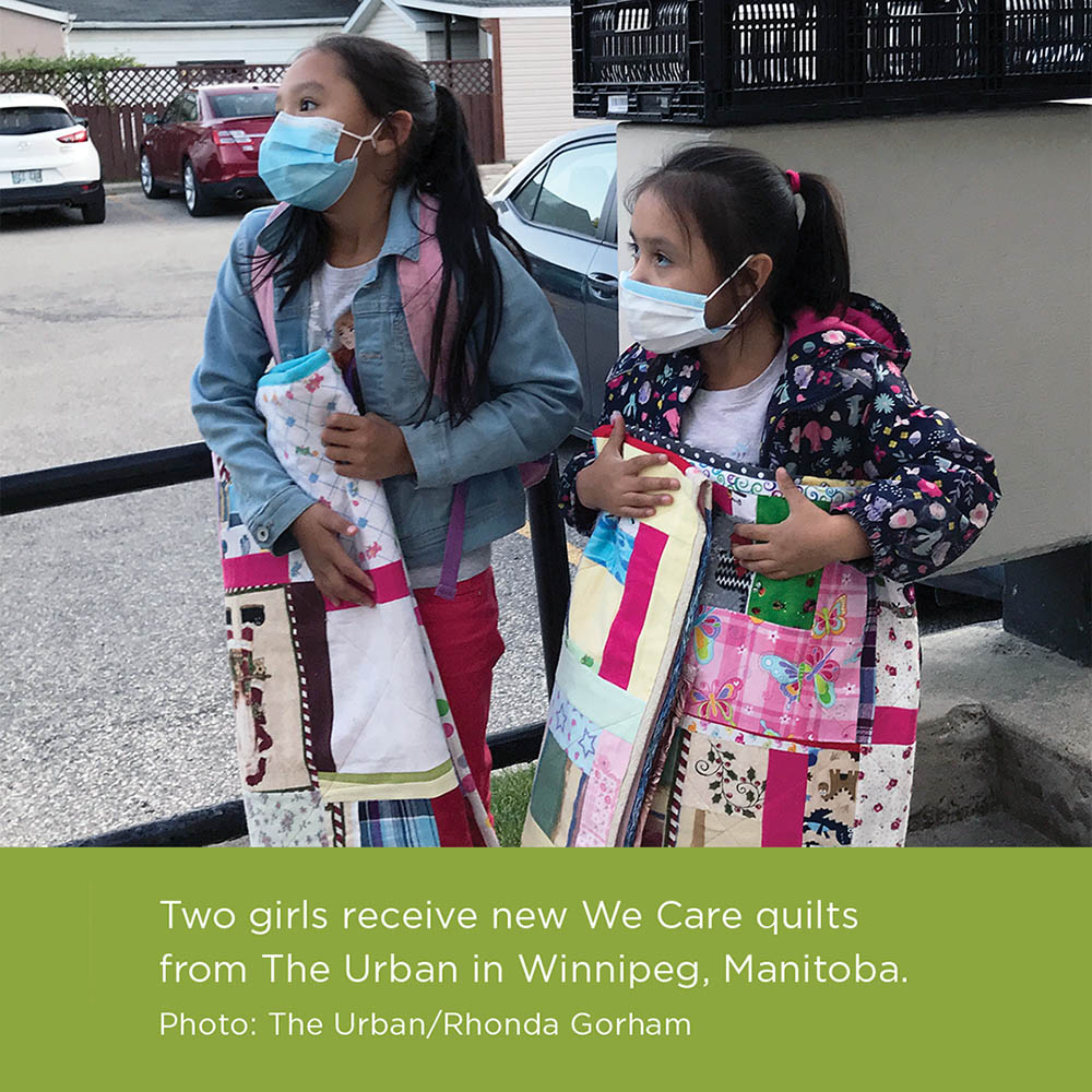 Two girls receive We Care quilts from The Urban in Winnipeg, Manitoba. Photo: The Urban/Rhonda Gorham