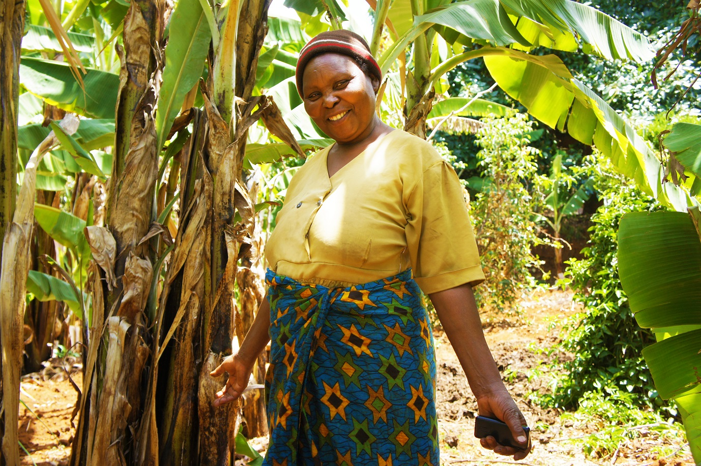 Farmer by her banana trees
