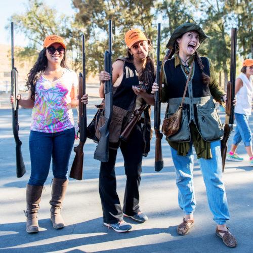 Three women prepare for a pheasant hunt with California Waterfowl.