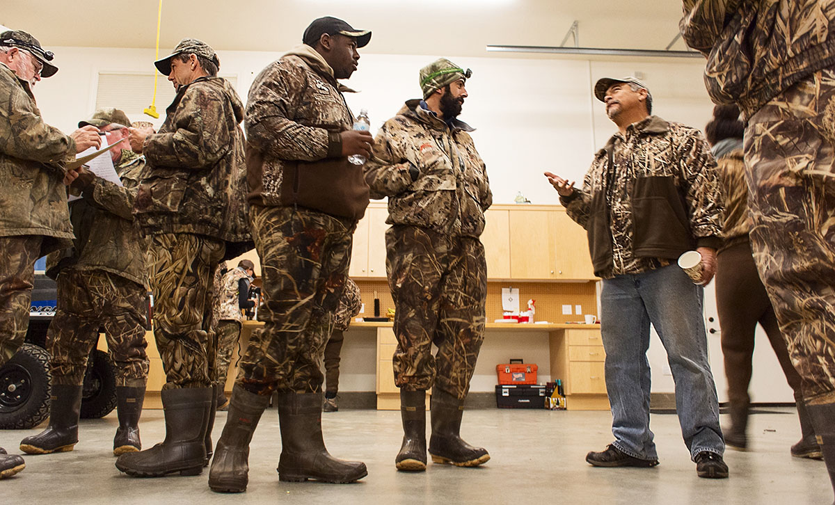 Men suited up for a duck hunt