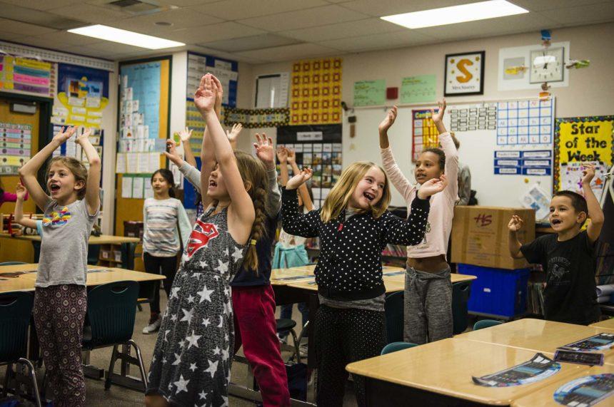 Kids having fun in the classroom.
