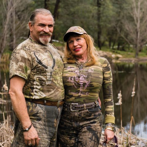 David and Tina Ventura stand in front of the largest pond on their property – a 2-acre pond with islands for nesting waterfowl.
