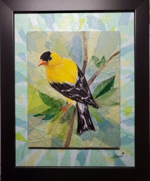 American Gold Finch in a Leafy Bower